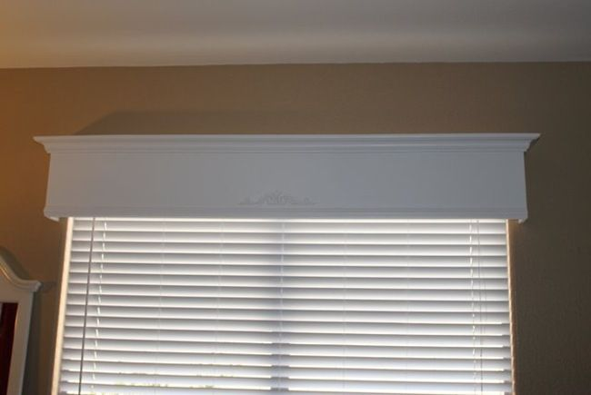 Pelmet box/valance/whateveryouwannacallit...no crown molding. Just not my style...cover with quilt batting and cool fabric.