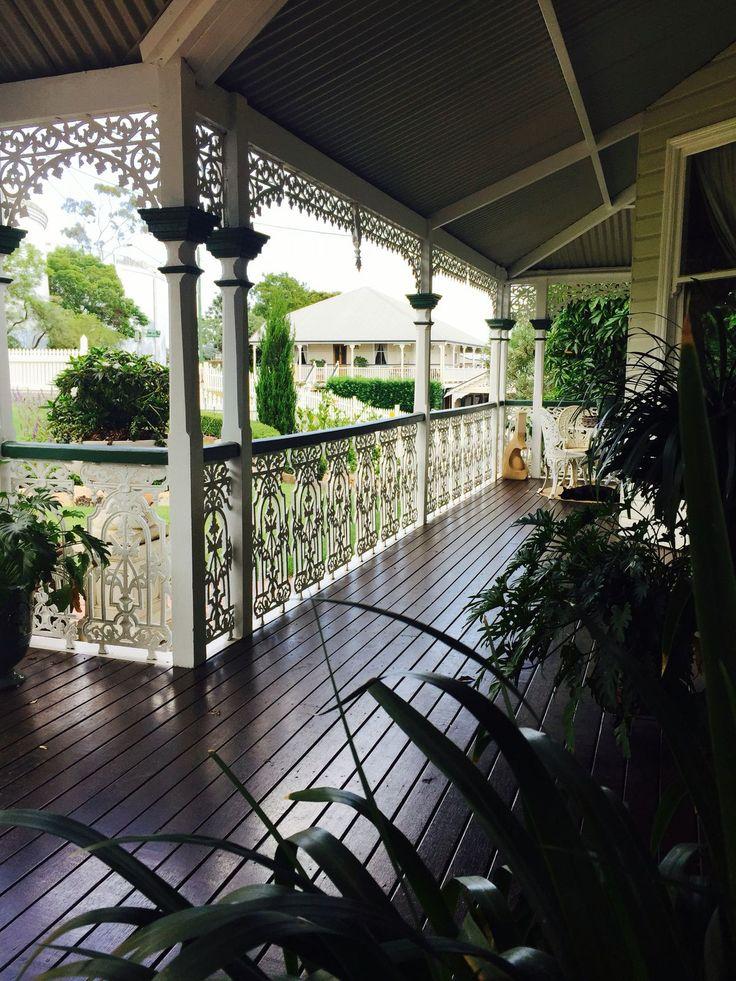 Queenslander verandah with fretwork and wrought iron handrails #queenslanderhomes