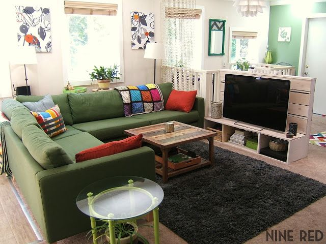 Sectional with TV floating in middle of room