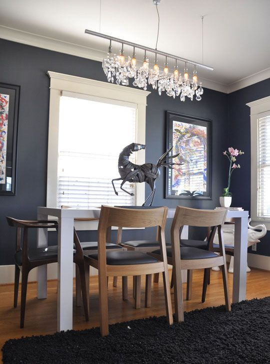 Dark Gray Walls Add Dining Room Drama — balance dark gray walls with something light. In the photo, there are lots of windows and white trim and the ceiling is a bright white. If you go by these principles, a darker gray should be fine.