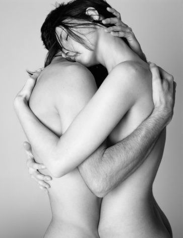 Couple embracing - their shoulders and arms form 2 overlapping hearts - black and white photo