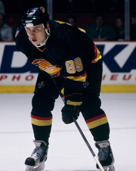 Alexander Mogilny of the Vancouver Canucks skates at the Montreal Forum circa 1990 in Montreal Quebec Canada