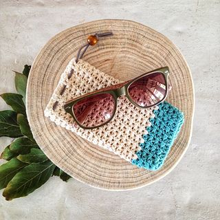 I always seem to be scratching my sunglasses, but I find the bulky boxes too cumbersome to carry around. Which is why a started playing around with some cotton yarn I had lying around…