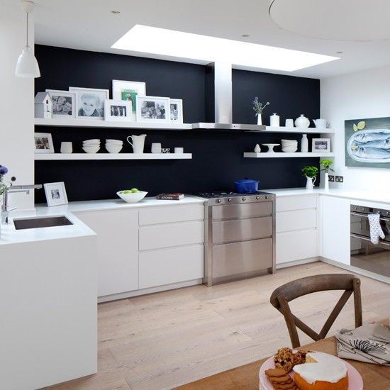 The easiest way to create a stylish monochrome scheme is to team white cabinetry with a dark paint colour for the walls. In this modern handleless kitchen, open shelving creates an attractive display area above a stylish stainless steel range cooker. http://www.housetohome.co.uk/kitchen/picture/monochrome-modern-kitchen