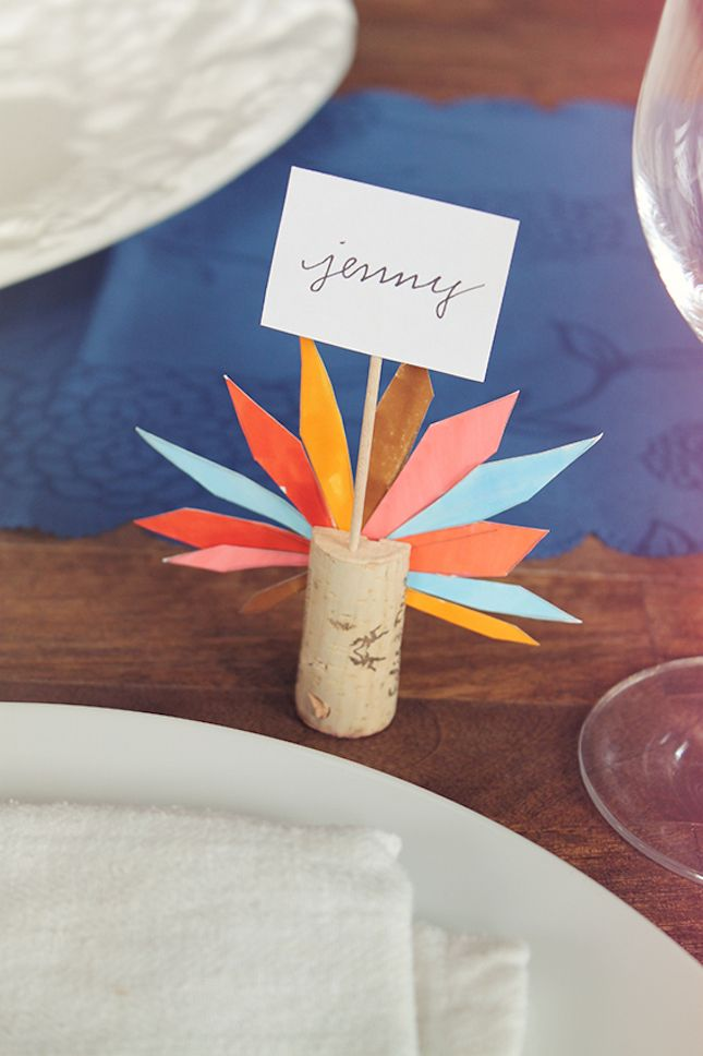 Paper + wine corks is all it takes to make these cute turkey feather name cards.