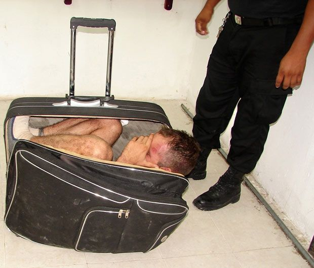 Prison inmate Juan Ramirez Tijerina is pictured curled inside a suitcase after he tried to escape from prison with the help of his girlfriend following a conjugal visit in Chetumal, Mexico. Ramirez is serving a 20-year sentence for a 2007 conviction for illegal weapons possession. His girlfriend was arrested and charges are pending.