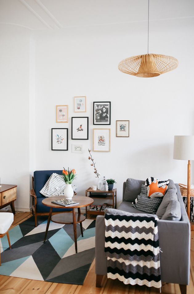 gray sofa and patterned rug, mid century chair