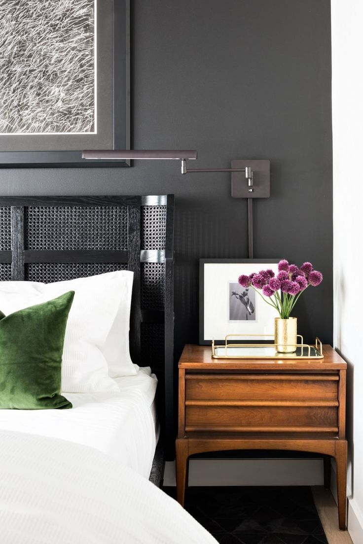 Create a calming atmosphere in the bedroom with dark