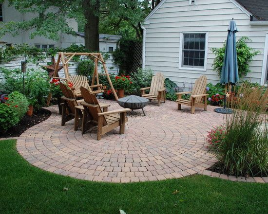 Phil could totaly make this patio! He did one for a friend when we were first married... it was a semi-circle starburst pattern - all brick. Beautiful!