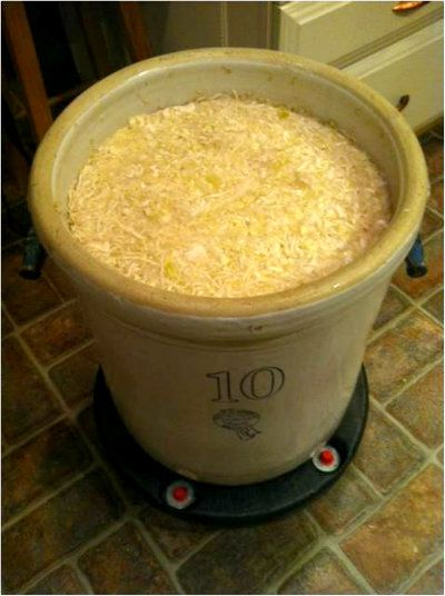Sauerkraut in a crock -I inherited some gigantic crocks from my grandmother. I live the idea of putting them on rolling garbage can bases!