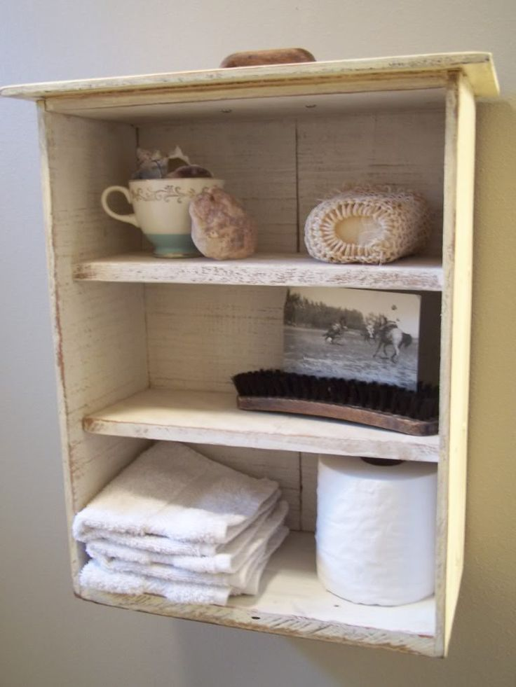 Shelves made from an old drawer. Turn drawer up on its end. Add some wood inside the drawer to make shelves and hang it up.