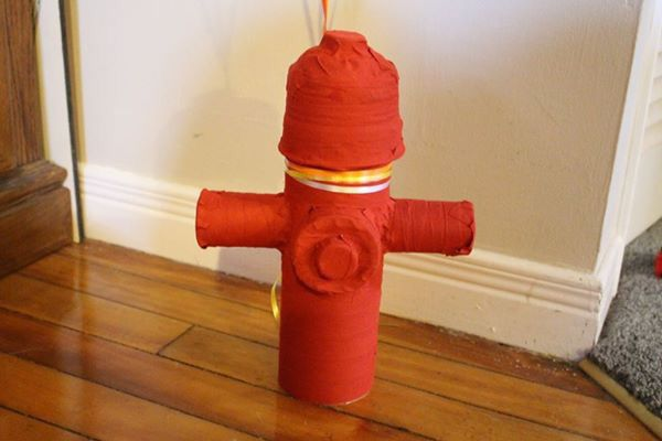 Fire hydrant made out of a tube, plastic containers & lids.