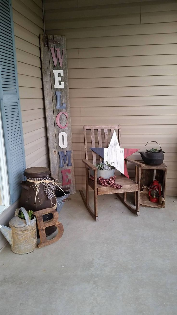 barnwood sign and letter, old chair, old milk can, watering can, cast iron pot all make for a nice decoration on the porch