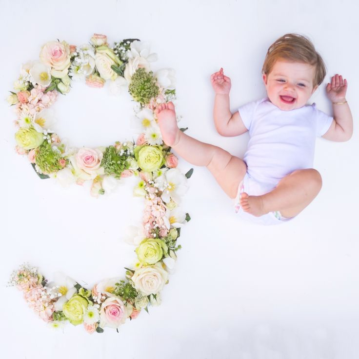 Monthly pictures. Baby girl. Fresh flowers. Nine months