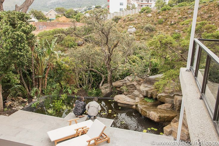 Style Council Exterior Design fish pond and sculpted  rock waterfalls with natural landscaping / Camps Bay Cape Town