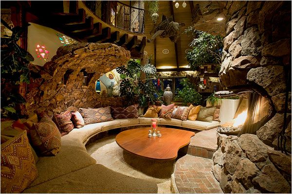 Magic Mushroom House, Aspen Colorado. I really like this intimate living room around the fireplace. The 6,000 square foot house has no corners.