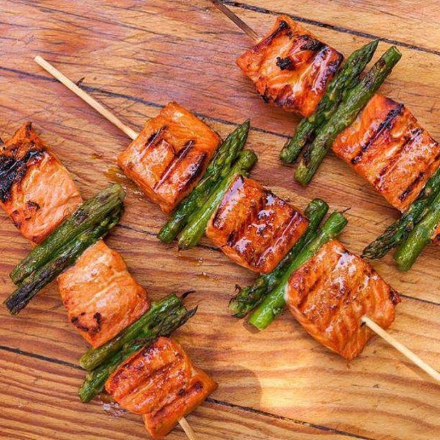 Salmon and Asparagus Kebabs! Keep reading for full recipe ⬇below  Recipe  Zest and juice of 1 large or 2 smalllemons, preferably Meyer 2tablespoonssoy sauce1(1-inch chunk)fresh ginger, peeled and shredded on a Microplane 1tablespoonbrown sugar 2pounds fresh wildsalmonfillets, about 1 inch thick, skinned and cut into 1-inch chunks 8bamboo skewers Kosher salt 1bunch medium-sizedasparagus, trimmed and halved crosswise Oil, for coating the grill Freshcilantro, for garnish (optio...