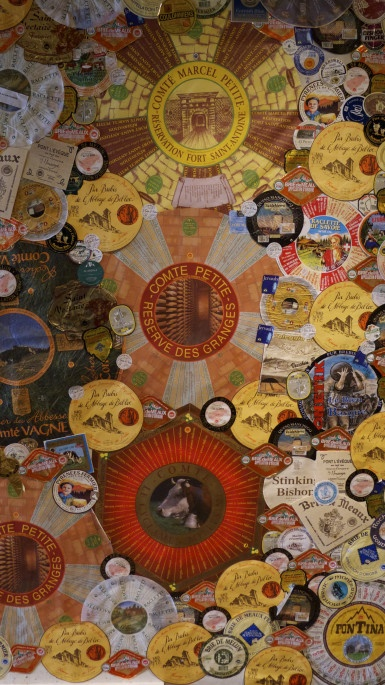 art wall of cheese wheel labels, nice.