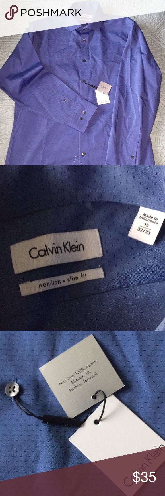 """CALVIN KLEIN slim fit dress shirt. Sz 15-32/33 NWT Non-iron cotton, slim fit men's shirt in Ballard Blue. Neck to bottom hem 28"""". (Any wrinkles are from the shopping bag- this is a non-iron shirt and launders or dry cleans beautifully) For husband, boyfriend, or high school grad, this is a great gift! Calvin Klein Shirts Dress Shirts"""
