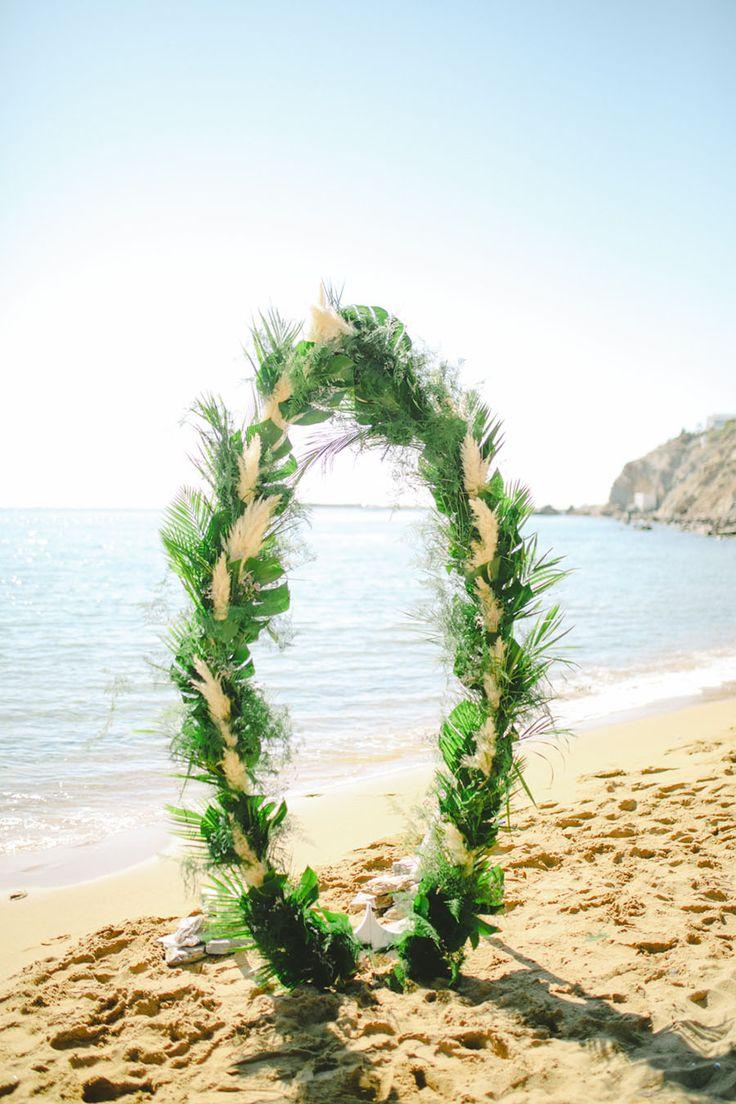 Tropical wedding arch