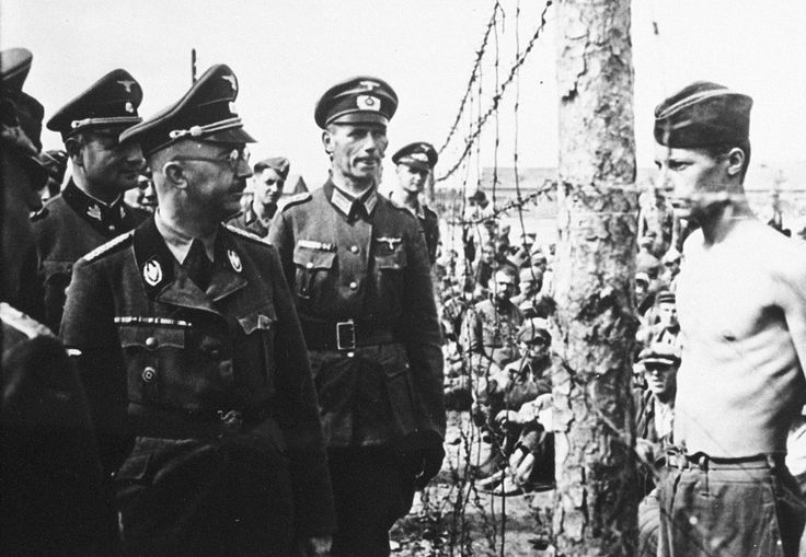 Heinrich Himmler (left, in glasses), head of the Gestapo and the Waffen-SS, inspects a prisoner-of-war camp in this from 1941 in Russia
