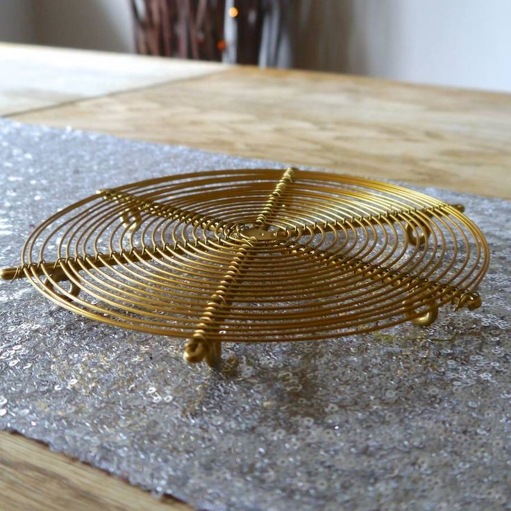 I've just found Brass Trivet. A very contemporary and stylish looking brass trivet made using concentric circles of thin metal twine.. £12.00