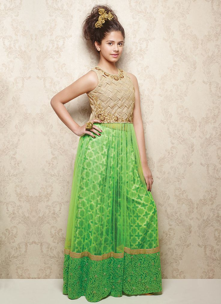 Doll Green Net Kids Anarkali INR Rs.8235 Green and beige shade net kids anarkali suit is fashioned with woven designs and embellishments of zardosi, beads and pearls. Comes with matching palazzo bottom.