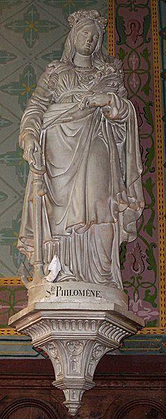 St. Philomena in St. Sulpitius Church in Heudicourt, Eure.  Stone,  19th century, unknown sculptor. Français : Sainte Philomène, dans l'église saint Sulpice d'Heudicourt (Eure).  Pierre, XIXe siècle, auteur inconnu.  Author: Theoliane June 2010.  (Wikimedia Commons)