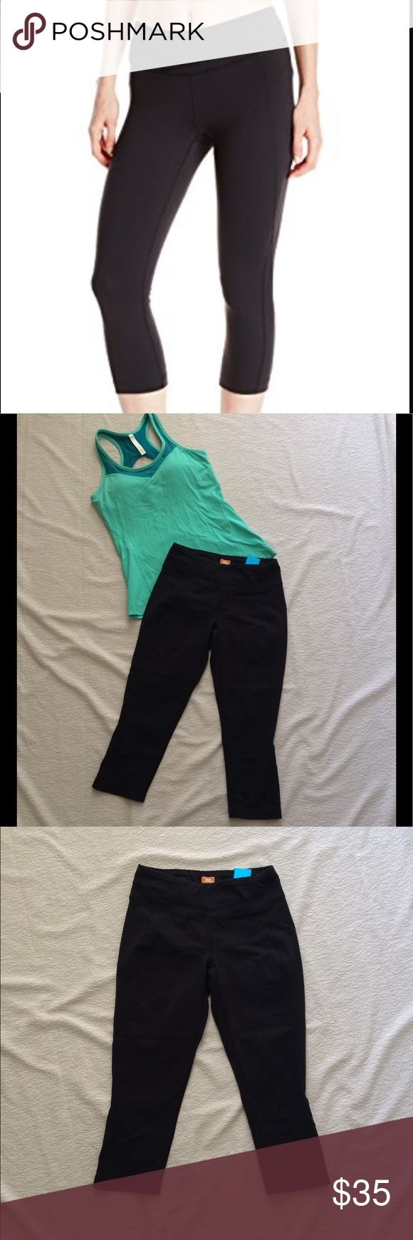 Lucy Hatha Black Capri Leggings Perfect for the yoga studio, the climbing gym and everywhere in between, the Lucy Hatha Capri Leggings for women provide flattering style and fantastic performance. These Lucy yoga leggings are made with supportive and moisture-wicking Powermax compression fabric. Flat-locked seams eliminate chafing and style lines create a slimming look.A gusset inset allows a full range of motion, and a body hugging is comfortable and supportive without being restrictive. SZ…