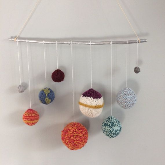 A beautifully hand knitted solar system. In a bright array of red, yellow, orange, green, blue and grey, this mobile would make a lovely addition to a childs room or nursery, and is perfect for that budding space explorer. Featuring a fabulous hand knitted Mercury, Venus, Earth, Mars, Jupiter, Saturn, Uranus, Neptune and Pluto (as it was a planet in my day!!) all in size order (although not exactly to scale). This mobile is arranged on a space age silver painted wooden stick, to be hung with…