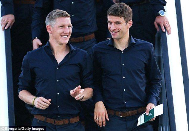 All smiles: Bayern Munich duo Bastian Schweinsteiger (left) and Thomas Muller (right) shar...