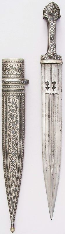 'Kama' (straight Caucasian dagger). Late-Ottoman era, 19th century. Steel, horn, silver, niello. Length with sheath 55.4 cm; length of blade: 37.8 cm; 5.4 cm wide. Weight: 445 gram. (Metropolitan Museum of Art, New York).