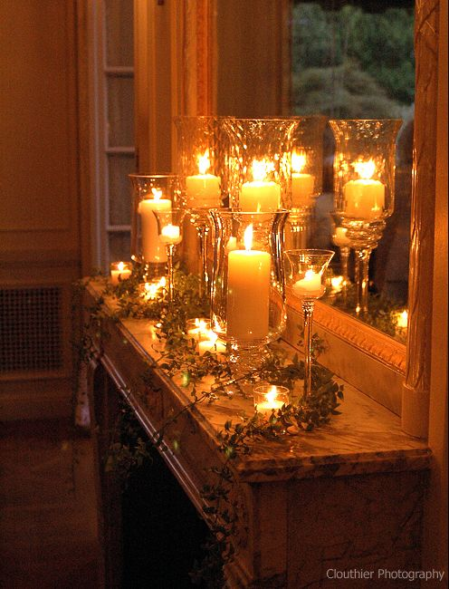 Create a beautiful mantle or hall buffet with Luminara flame-effect candles. You can find inexpensive hurricanes in all shapes, sizes and colors at Home Goods.