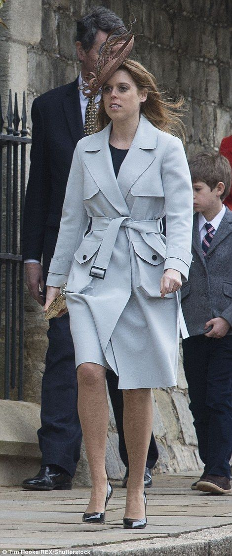 Princess Beatrice emulated her grandmother's pastel look in a pale blue trench coat and chocolate coloured hat