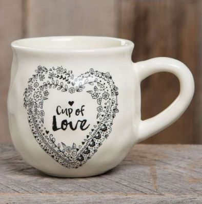 """With a handcrafted feel and generous 16-ounce size, this """"happy"""" ceramic mug features """"cup of love"""" saying and a heart printed on the inside bottom. Perfect for gifting. Dishwasher and microwave safe."""