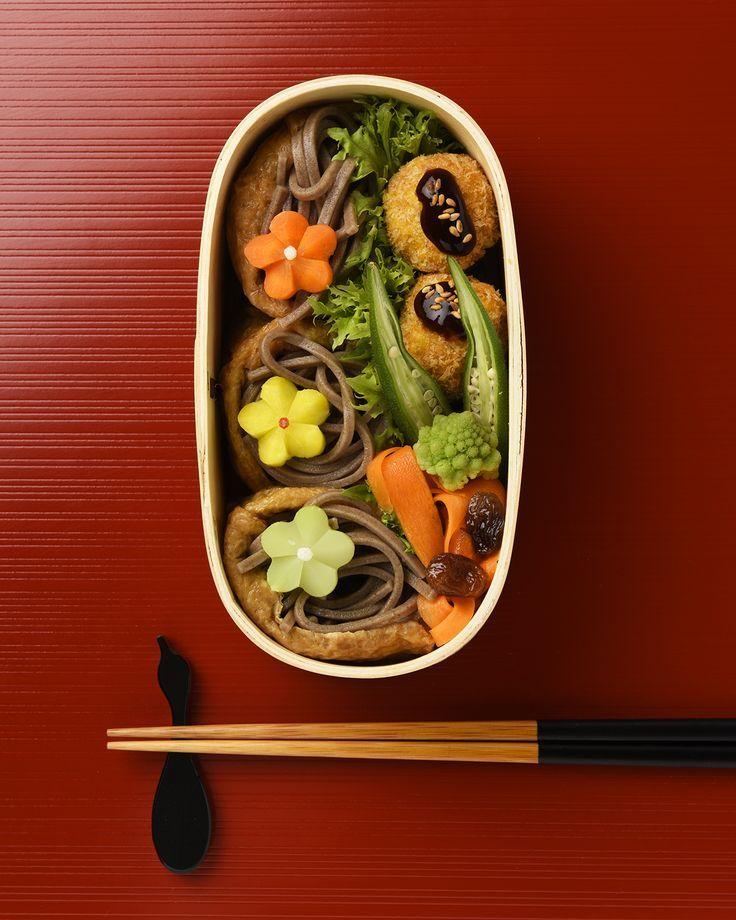 Soba-filled Inari-zushi Bento Box, featuring korokke (croquettes), okra, and veggie flowers