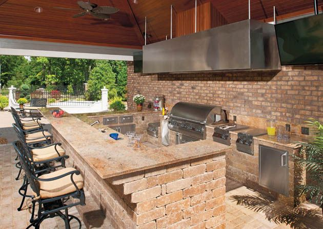 An Outdoor Kitchen Complete With Hood Create 5 Star Meals