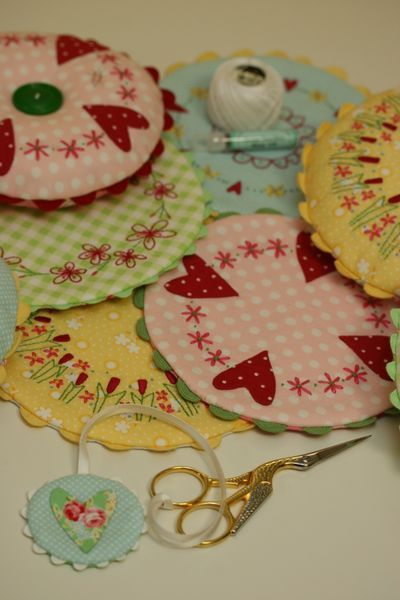 Simply sweet.  Pin cushions or doilies or scissor keep.