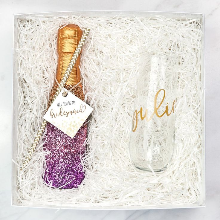 Alright ladies, it's time to get crafty! These DIY glitter champagne bottles are an easy, adorable way to *pop* the question—pun intended—to your bridesmaids. T