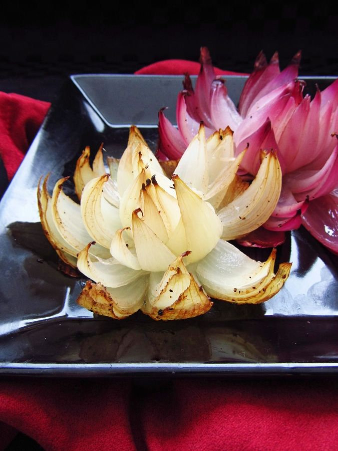 Onion Flowers -- so easy -- These flowers are made by simply slicing an onion into eighths, without cutting all the way through the onion so that it stays intact on the bottom, but the 'petals' fall down when baking to create a beautiful flower shape.
