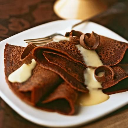 Chocolate Crepes with Nutmeg Vanilla Sauce: To make these thin dessert pancakes even more indulgent, top with whipped cream.    More chocolate and vanilla recipes: http://www.midwestliving.com/food/desserts/chocolate-vanilla-dessert-recipes/page/3/0