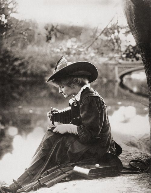 Woman with Kodak camera, c1900