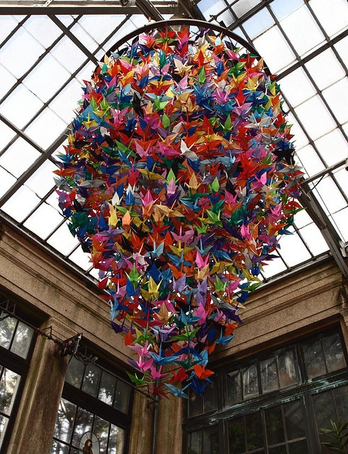 """""""One Thousand Cranes"""" should be the name of this origami chandelier. Colorful, but I'd choose a softer pallet, perhaps all one color -- remember, when light shines through bright colors, the chandalier may be gorgeous, but it makes everyone in the room look sick!"""