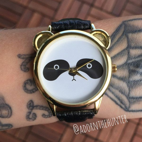 Adorable panda face on a gold plated watch face and a vegan leather black band.