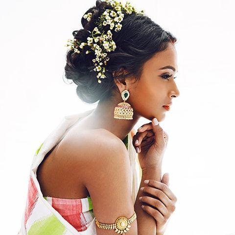 South Indian bride. Gold Indian bridal jewelry.Temple jewelry. Jhumkis.White silk kanchipuram sari. Updo with fresh jasmine flowers. Tamil bride. Telugu bride. Kannada bride. Hindu bride. Malayalee bride.Kerala bride.South Indian wedding.