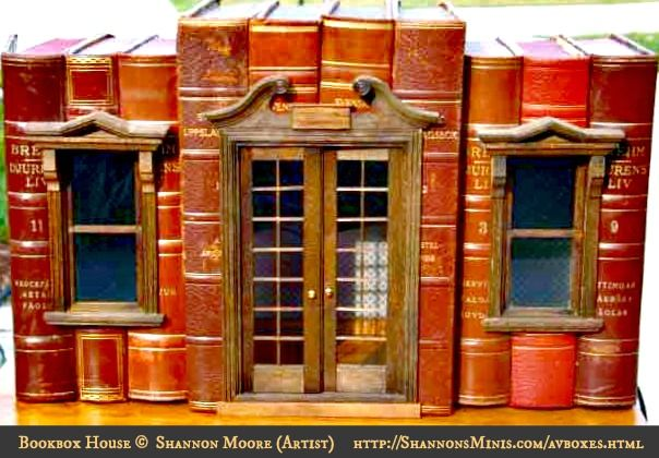 Bookbox Houses © Shannon MOORE (Artisan, Miniature Maker. Florida, USA).  Real books hollowed-out so that a miniature vignette setting can be placed inside.  Available at her website, SharonsMinis.com