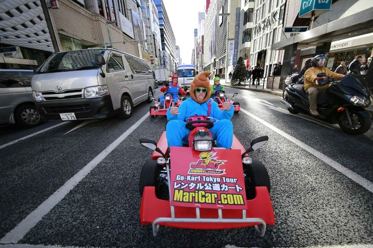 People dressed as video game character Super Mario and other characters as they drive custom built Go-Karts through a street in Tokyo's Ginza shopping district Thursday, Feb. 2, 2017. (AP Photo/Shizuo Kambayashi)/XKAN108/17033202026671/STAND ALONE/1702020646