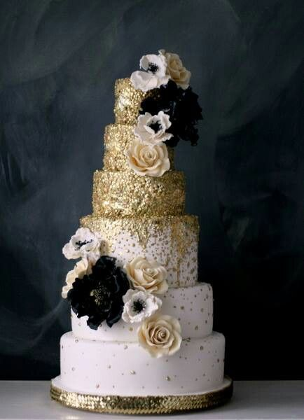 Pale pink wedding cake with gold glitter and floral detail (anemone and black flowers)
