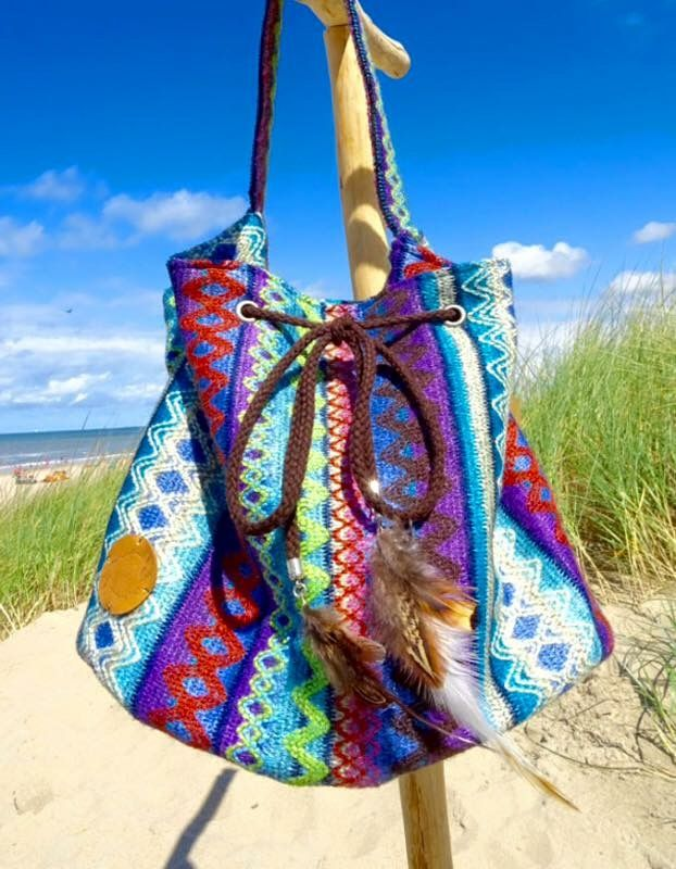Handmade bag aztec with feathers. In bohemian gypsy hippie style.