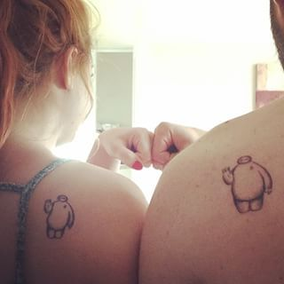 This adorable Baymax appreciating couple: | 21 Disney Couple Tattoos Your Heart Will Dream About